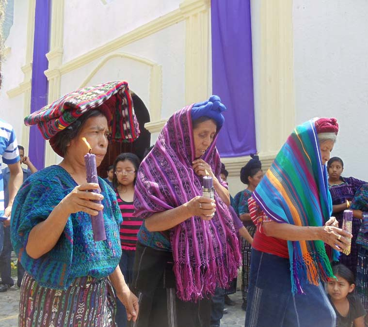 Indigenous Women holding candles during Semana Santa in Santa Catarina Palopo